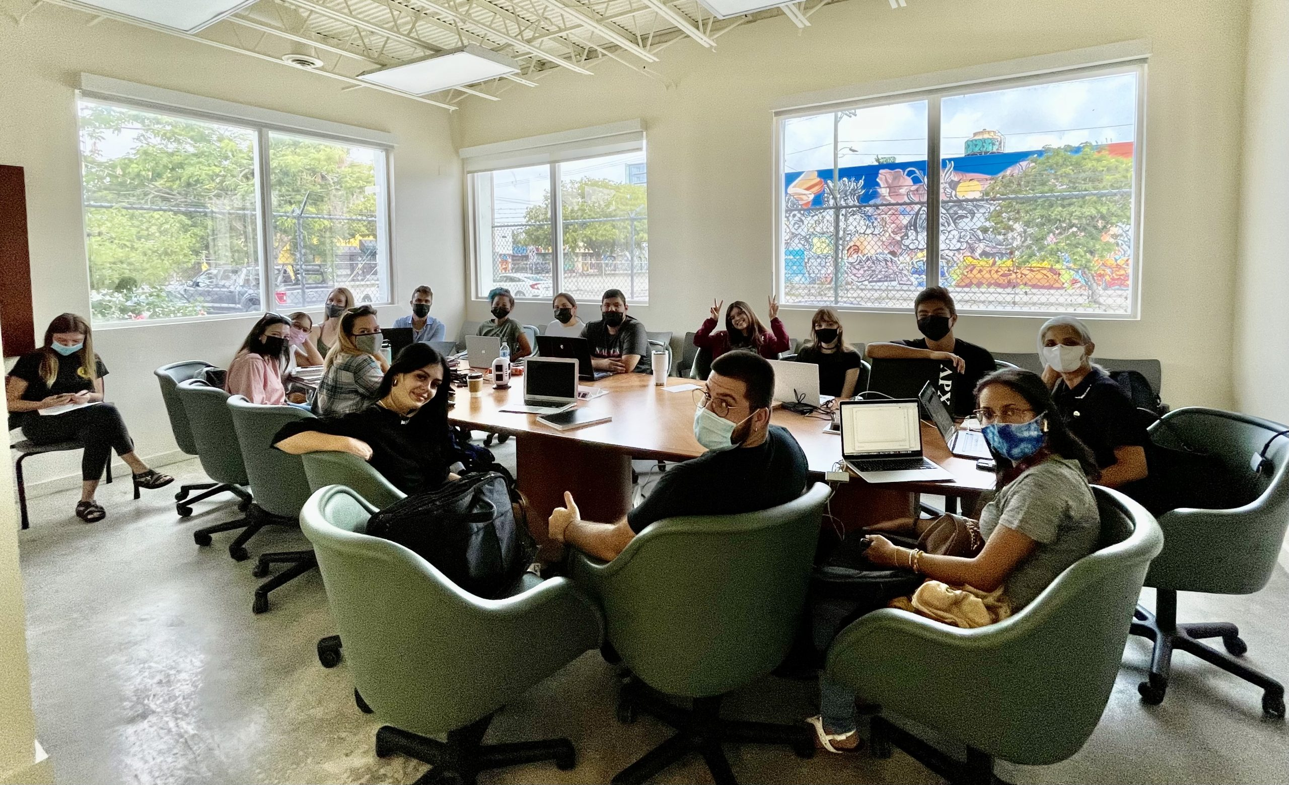 Image of students in the conference room with the windows open